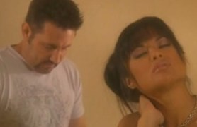 tanned brunette gets fucked on a bed