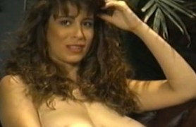 curly brunette with white natural tits in action.