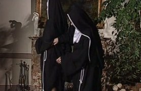 lesbian nuns lick each other.