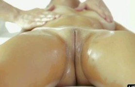 masseur takes command of her fresh body.